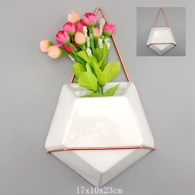 cream ceramic plant pots with metal wire